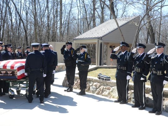 Honor Guards from the Battle Creek Police Department, including Chief Jim Blocker and from Fort Custer National Cemetery salute retired Chief Theral Smith Thursday, March 22, 2018.