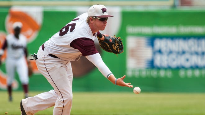 UMES first baseman Skylar Murray (16) flips the ball to first after fielding a grounder against Savannah St in the opening round of the MEAC Tournament at Arthur W Perdue Stadium.