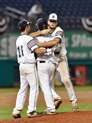 Dallastown's Michael Carr, right, and Zach Ness, left, hug pitcher Alex Weakland following Dallastown's 1-0 loss in the PIAA Class 6A championship on Friday at State College.
