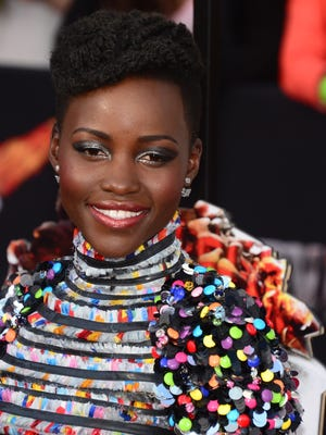 Actress Lupita Nyong'o arrives on the red carpet for the 2014 MTV Movie Awards at the Nokia Theater in Los Angeles, California, in this April 13, 2014 file photo.