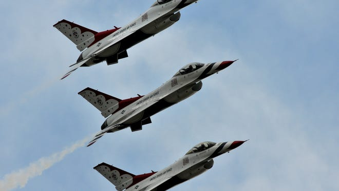 The U.S. Air Force Thunderbirds fly in tight formation while practicing for this spring's Melbourne Air and Space Show at Orlando Melbourne International Airport.
