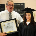 St. Landry Parish Sheriff Bobby Guidroz presents the Louisiana High School Equivalency Diploma to Jessica Puckett during a ceremony Tuesday at the parish jail.