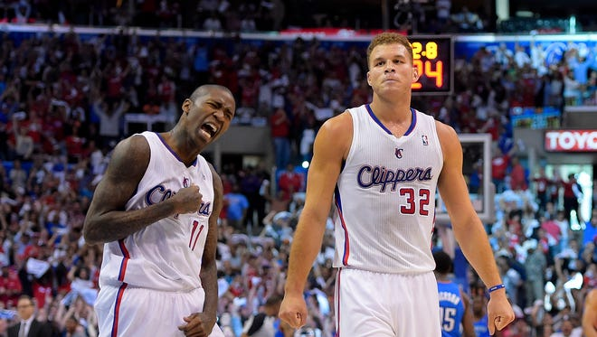 The Clippers' Jamal Crawford, left, celebrates with Blake Griffin in the closing seconds of Game 4 against Oklahoma City on Sunday in Los Angeles. The Clippers won 101-99.