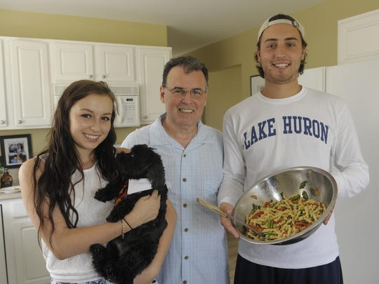 Bill Hall, center, executive chef at Andiamo West Restaurant in Bloomfield Township, sometimes cooks for his family, including two of his four kids, Natalie, 17, and Anthony, 21, at home on his day off.