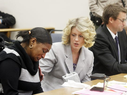 Deputy District Attorney Paige Clarkson, center, consoles