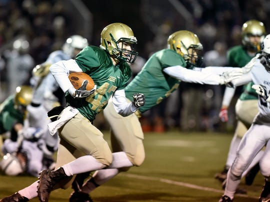 York Catholic's Benjamin Nelson-Moir carries the ball against Newport in the first half of a PIAA District 3 Class 2A title game Saturday, Nov. 11, 2017, at Boiling Springs. York Catholic lost 26-7 to Newport in a rematch of last year's district championship game.