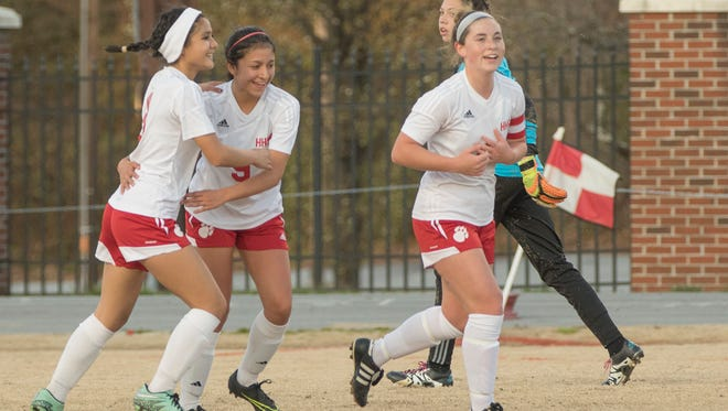 Hendersonville soccer players, including Lupita Melendez (No. 9), celebrate a goal during a March 22 home win over Owen.
