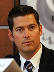 Rep. Sean Duffy listens during a congressional hearing at Wausau City Hall, Oct. 31, 2011.