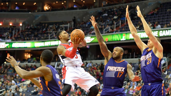 Dec 4, 2015: Washington Wizards guard Bradley Beal (3) shoots in front of Phoenix Suns forward P.J. Tucker (17) and center Alex Len (21) during the third quarter  and at Verizon Center. Washington defeated Phoenix 109-106.