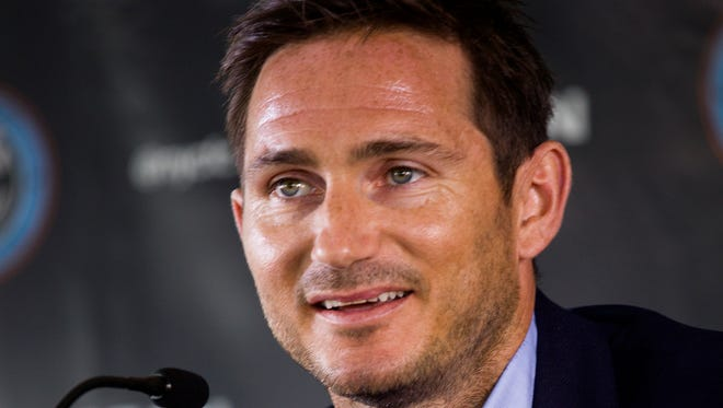 Frank Lampard, of England, speaks at a news conference where he was introduced as a member of the MLS expansion club New York City FC,  Thursday, July 24, 2014, in New York.