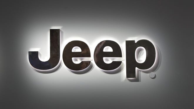 A Jeep logo is shown at the North American International Auto Show in Detroit, Monday, Jan. 14, 2019.