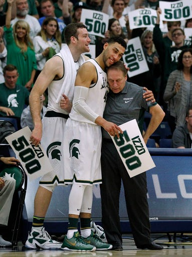 Michigan State coach Tom Izzo, right, gets a hug from
