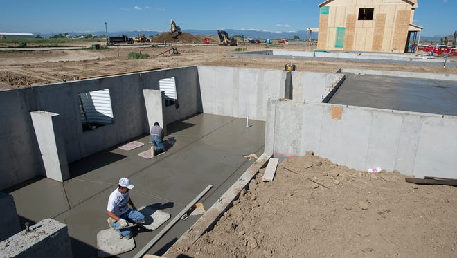 Crews work to lay the foundation on a new home in the Mountain View subdivision in Wellington Thursday, June 2, 2016. Prices for new homes in the area are rising into the high $200,000 range.