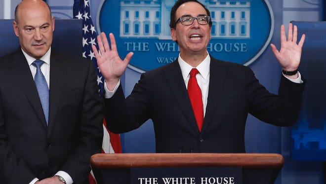 Treasury Secretary Steven Mnuchin, right, joined by National Economic Director Gary Cohn, speaks in the briefing room of the White House in Washington, April 26, 2017.