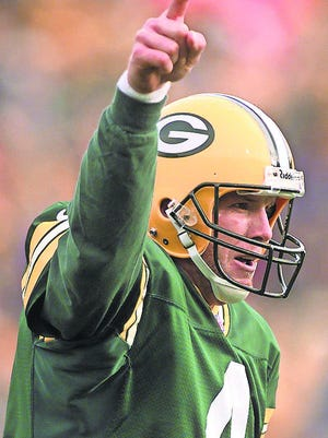 Brett Favre celebrates a two-point conversion as the Packers' quarterback.