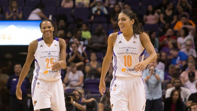Mercury Guard Monique Currie (25) laughs with Guard Marta Xargay (10) after a play during the game against the Phoenix Mercury vs. Los Angeles Sparks at US Airways Center, Friday, September 11, 2015, in Phoenix, Ariz. Currie finished with a game high 22 points.