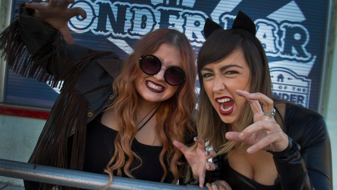 Christine Feola as Catwoman and Amy Malkoff as Ozzy Osbourne for a story on Halloween events. Chistine and Amy are part of the Asbury Park music scene. Photo taken on  October 17, 2014 in Asbury Park,  NJ. Peter Ackerman/Staff Photographer