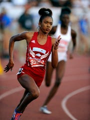 Hirschi's Azan Sargusingh runs the first turn of the Class 4A girls 400m during the UIL State Track and Field Championships on Saturday, May 13, 2017, at Mike A. Myers Stadium in Austin.