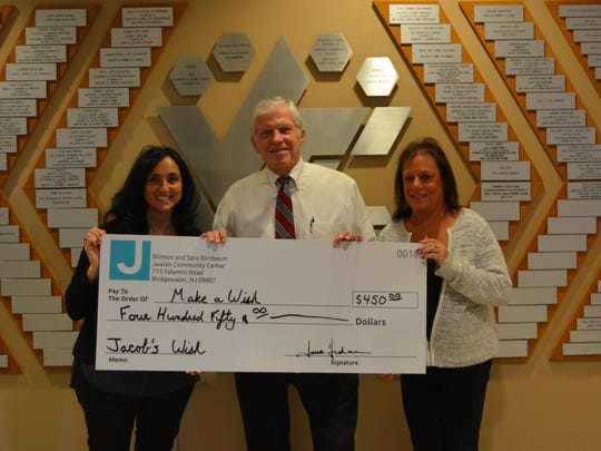 "The Shimon and Sara Birnbaum Jewish Community Center in Bridgewater recently made a donation to Make-A-Wish New Jersey. The JCC Adult Services Department collected $450 to benefit ""Jacob,"" a 4 year old boy from Bound Brook, whose wish is to visit Disney World. Jacob and his family are planning a trip to Disney World in Orlando in June. Pictured at the JCC presenting the check to Make-A-Wish New Jersey are from left to right: Laura Friedman, JCC executive director, Michael McGarry, director of planned giving, Make-A-Wish New Jersey, and Lisa Kopman, director, JCC Adult & Senior Programs. The collection for Make-A-Wish New Jersey was part of an overall community service initiative at the JCC called ""March Mitzvah Madness,"" in which each JCC program department a ""mitzvah"" — or good deed — to benefit the local community. Additional activities included a collection of more than 20 bags of food for a local food pantry; and a pasta party organized which raised $2,200 for Special Olympics Somerset Country. The JCC is at 775 Talamini Road in Bridgewater. Visit ssbjcc.org or call 908-725-6994, ext. 201."