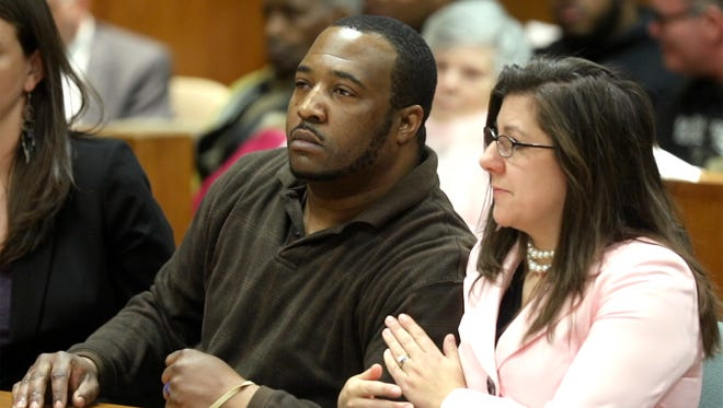 Assistant Public Defender Elizabeth Riley pats Silvon Simmons arm after Monroe County Court Judge Christopher Ciaccio announces reversing the weapons conviction against Simmons.  Simmons was also found not guilty of attempted murder against a police officer.