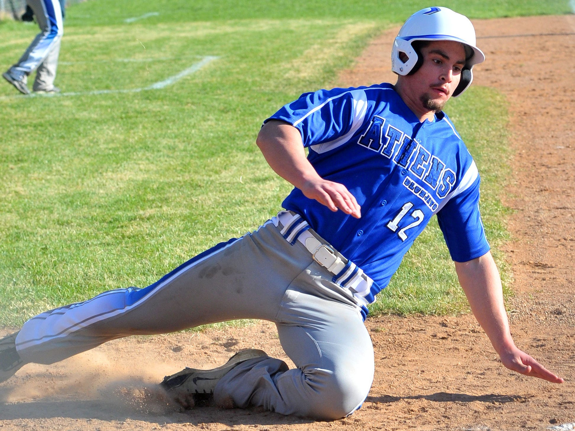 Athens' Lane Tessmer slides into home with the Bluejays second run of the third inning against Marathon Thursday.