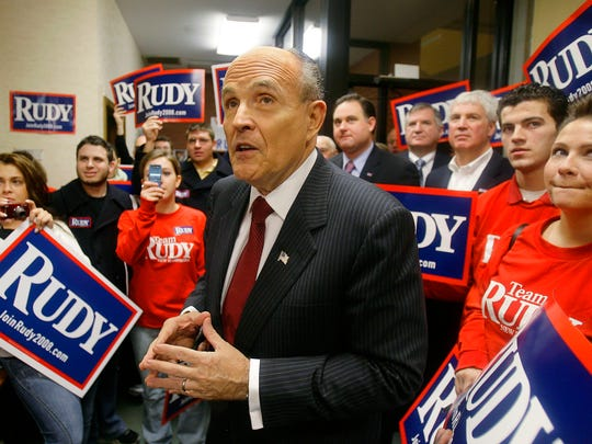 Rudy Giuliani meets with volunteers at his campaign