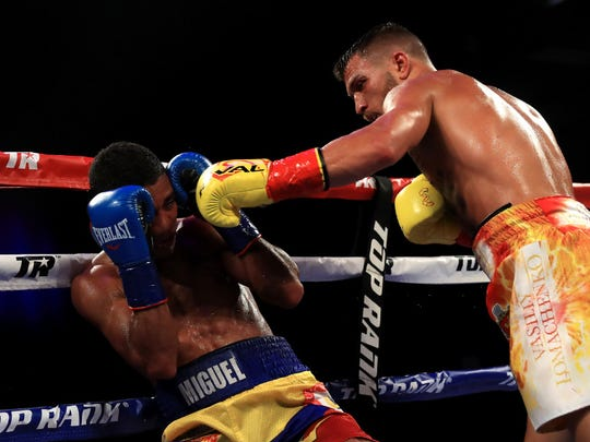 Vasyl Lomachenko connects with a left hand as Miguel Marriaga covers up.