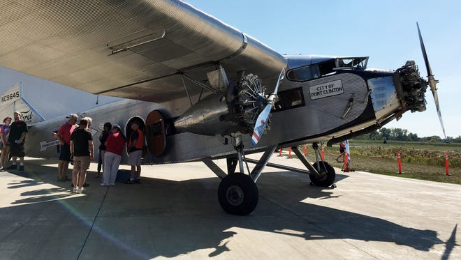 Passengers take a ride on a 1928 Ford Tri-Motor owned by the Liberty Aviation Museum and operated by Experimental Aircraft Association on Sunday, Sept. 17, 2017.
