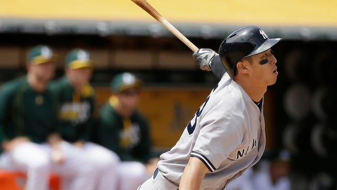 New York Yankees' Rob Refsnyder hits an RBI-double to deep right field off Oakland Athletics starting pitcher Sean Manaea in the fourth inning of a baseball game Saturday, May 21, 2016, in Oakland, Calif.