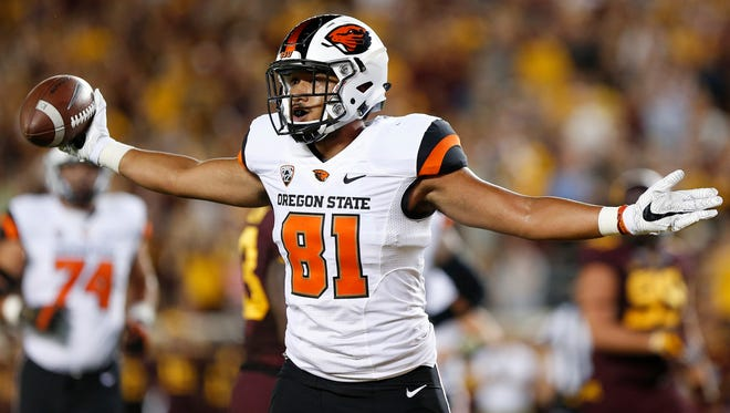 Oregon State player Noah Togiai (81) celebrates after a touchdown against Minnesota during an NCAA college football game Thursday, Sept. 1, 2016, in Minneapolis.