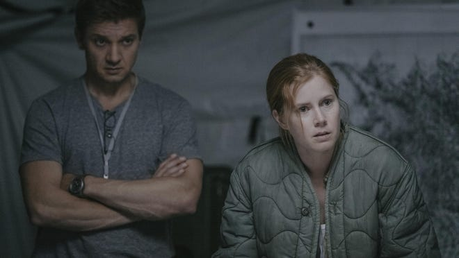 """Jeremy Renner, left, and Amy Adams star in """"Arrival."""""""