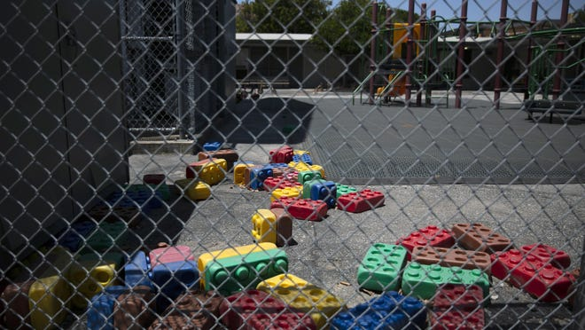 Dusty Lego-style toys are scattered in the playground of an elementary school in Los Angeles on Friday, when  Gov. Gavin Newsom laid out strict criteria for school reopenings that makes it unlikely the vast majority of districts will have classroom instruction in the fall as the coronavirus pandemic surges.