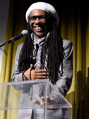 Honoree Nile Rodgers accepts the Recording Academy's President's Merit award onstage during the eighth annual Grammy week event in Los Angeles.