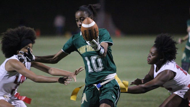 Lincoln's Kayley Farmer slips between two Leon defenders for a touchdown during their game this past week at Florida A&M's turf fields as part of a preseason jamboree.