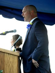 Pictured here, Lancaster High School Principal Scott Burre addresses the 2018 graduates. This year, LHS will be following state health guidelines and will be holding its ceremony differently, having students drive to the school and pick up their diplomas individually, before compiling everyone's appearances into one full ceremony.