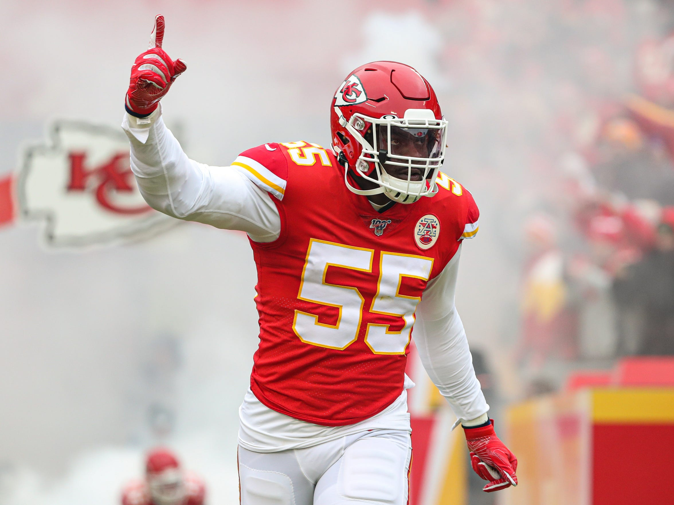 Jan 12, 2020; Kansas City, Missouri, USA; Kansas City Chiefs defensive end Frank Clark (55) is introduced before a AFC Divisional Round playoff football game against the Houston Texans at Arrowhead Stadium. Mandatory Credit: Jay Biggerstaff-USA TODAY Sports