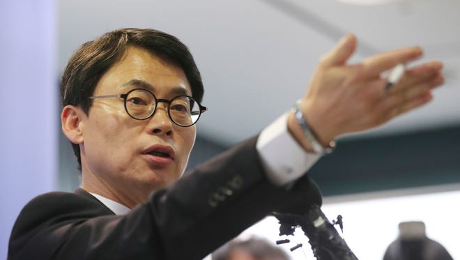 A spokesman of the special prosecution team, Lee Kyu-chul, gestures as he takes questions from reporter during the news briefing in Seoul, South Korea, on Tuesday. South Korean special prosecutors said they would indict Samsung's de facto chief Tuesday on bribery, embezzlement and other charges linked to a political scandal that has toppled President Park Geun-hye.