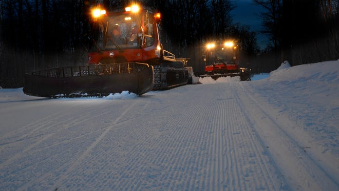 Groomers at work on the Birkie Trail.