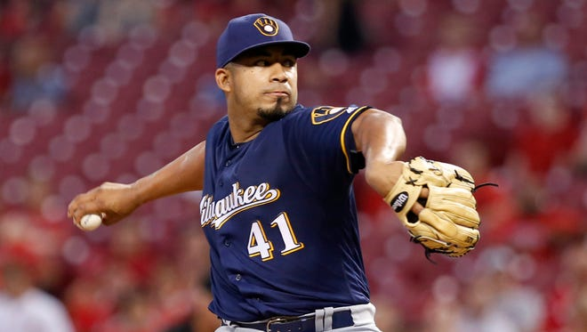 Brewers starting pitcher Junior Guerra throws against the Cincinnati Reds during the second inning at Great American Ball Park on Wednesday night.