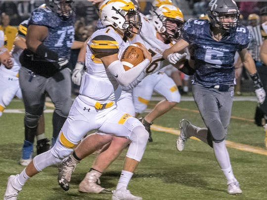 "Red Lion""s Zach Throne runs the ball with Dallastown's Steven Werner giving chase during football action Friday, November 3, 2017   J. Kelley Dentry photo"