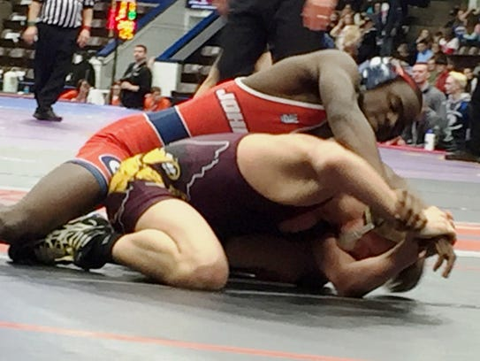 John Glenn's JaCorey (top) toppled Davison's Travis Eads, 6-4, with a two-point takedown in overtime.