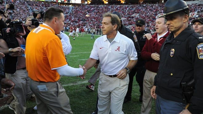Alabama head coach Nick Saban and Tennessee head coach Butch Jones meet center field following their 45-10 victory over the Volunteers Saturday, Oct. 26, 2013 at Bryant-Denny Stadium in Tuscaloosa, Ala. (MICHAEL PATRICK/NEWS SENTINEL)