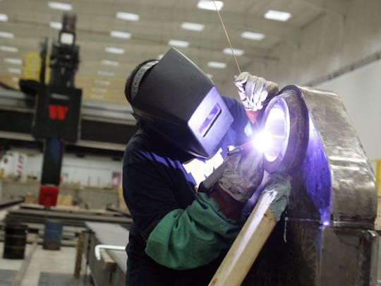 The federal government awarded $8 million to the University of Michigan's Institute for Research on Labor, Employment and the Economy to assist communities and companies in the three states that have been impacted by job losses from downsizing in the defense industry.