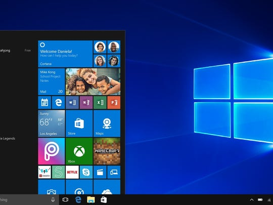 A computer displaying a Windows 10 home screen is shown next to the Windows logo