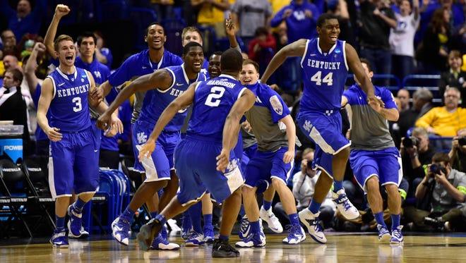 The Kentucky Wildcats celebrate Sunday's win against Wichita State.