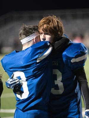 Southeastern seniors Dalton Chaffin (left) and Trey Brown (right) embrace after the Panthers' season-ending loss to Dawson-Bryant in a Division VI, Region 23 regional semifinal. Southeastern finished the season at 11-1 — the best mark in school history.