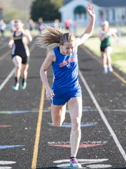 Zane Trace's Abbey Mohan crosses the finish line in the 200-meter dash, an event she won with a time of 26.7, at the Ross County Meet in Frankfort, Ohio, on May 1, 2018. Mohan won three events on the day and was named meet medalist as the Pioneers won the girls title.