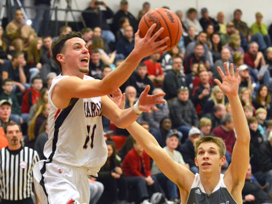Marshall's Jacob Brubaker drives the basket as Harper