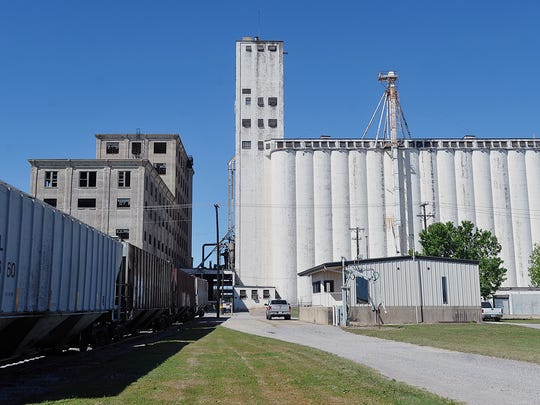 In this file photo, the Burlington Northern railroad tracks pass between the Attebury Grain elevators and the vacant General Mills property next door. A city ordinance chance would make it illegal for pedestrians to walk between, under or in front of rail cars. The practice has been  an issue, especially at the Seventh Street crossing where rail cars often park for long periods of time.