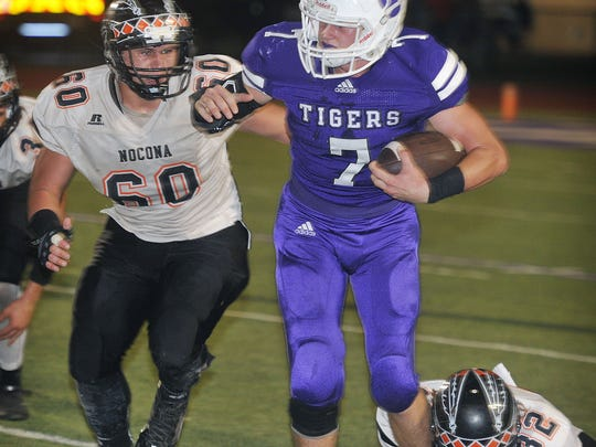 Nocona's Jason Daughtery (60) and Hunter Fenoglio (32) work together against Jacksboro ball carrier Ty Kennedy (7) during second quarter action Friday night in Jacksboro.